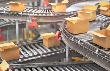 multiple brown boxes on conveyor belts